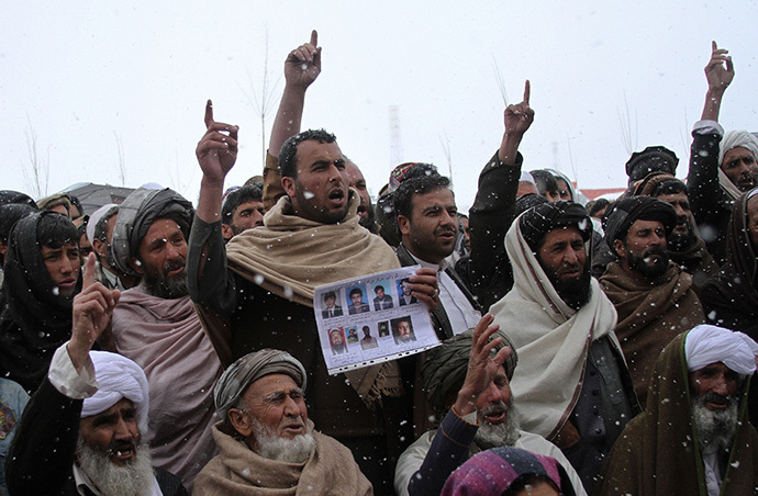 Afghan villagers shout slogans during a protest against U.S. special forces accused of overseeing torture and killings in Wardak province February 26, 2013. (Reuters)