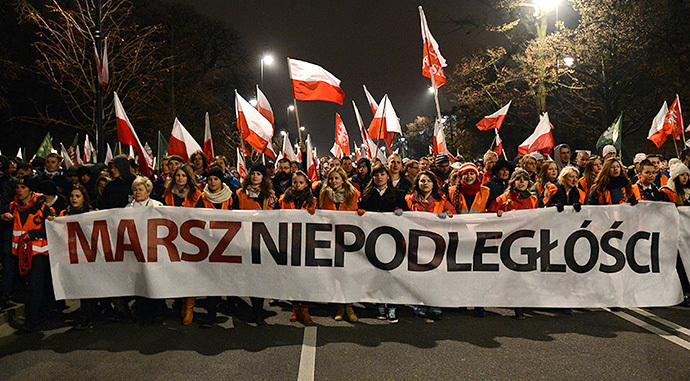 Far-right protesters take part in their annual march, which coincides with Poland's national Independence Day in Warsaw on November 11, 2013. (AFP Photo / Janek Skarzynski)