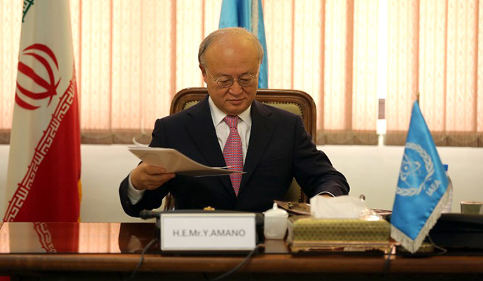 International Atomic Energy Agency (IAEA) Director General Yukiya Amano attends a meeting with the Head of Iran's Atomic Energy Organisation Ali Akbar Salehi (unseen) in Tehran on November 11, 2013. (AFP Photo / Atta Kenare)