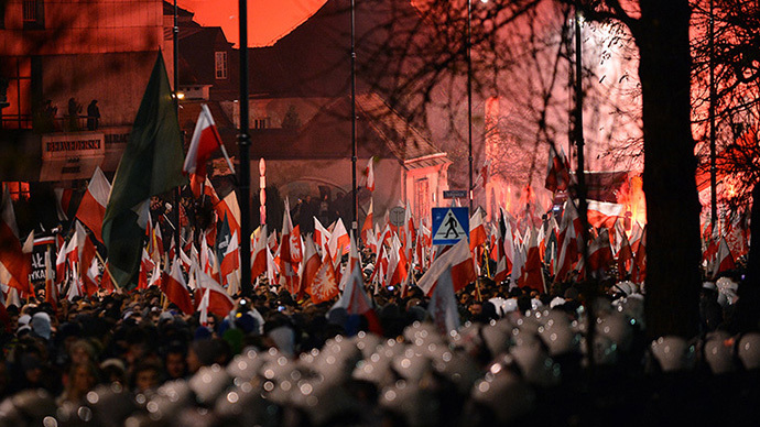 Far-right protesters walk past the Russian Embassy during their annual march, which coincides with Poland's national Independence Day in Warsaw on November 11, 2013. (AFP Photo / Janek Skarzynski)