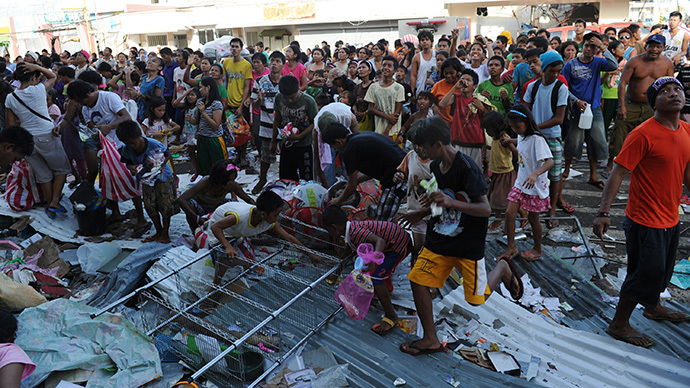 Deadly clashes rage in typhoon-ravaged Philippines as survivors fight for food