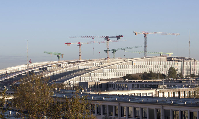 A view of the current NATO headquarters (Bottom) and the new headquarters under construction (Back) in Brussels on November 13, 2013. (AFP Photo/Virginia Mayo)