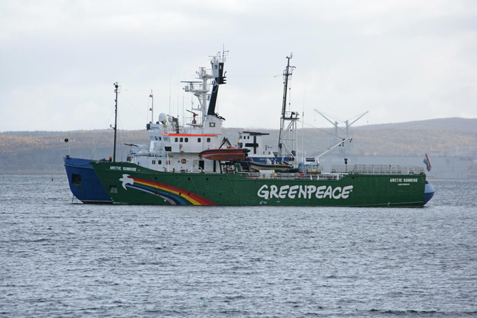 A handout photo provided by Greenpeace International shows the Greenpeace ship, Arctic Sunrise, being towed on September 24, 2013 into the Russian port of Murmansk by a Russian Coast Guard vessel. (AFP/Greenpeace International)