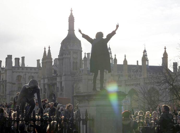 A demonstrator gestures as students occupy the grounds of Senate House at Cambridge University, in Cambridge eastern England November 24, 2010. (Reuters/Darren Staples)