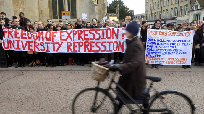 Students and staff from Cambridge University take part in a silent protest outside Senate House as Lord Sainsbury was installed as the University Chancellor, in Cambridge, England March 21, 2012. (Reuters/Neil Hall)