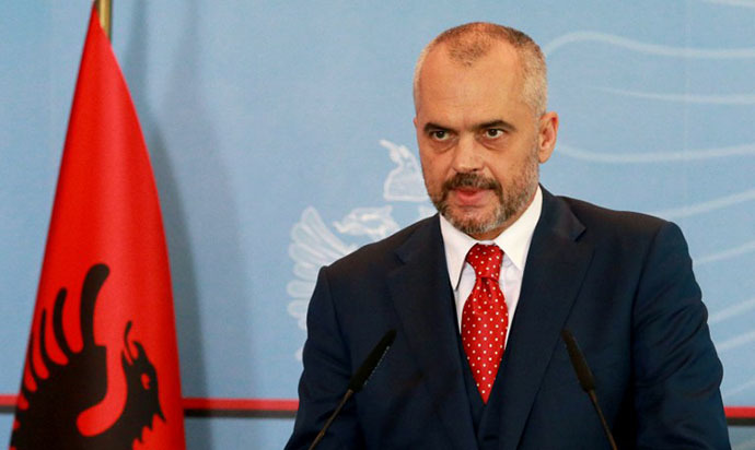 Albanian Prime Minister Edi Rama delivers a speech during a televised address to Albanians in Tirana on November 15, 2013. (AFP Photo / Gent Shkullaku)