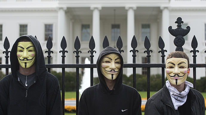 Supporters of the group Anonymous, march in a protest against corrupt governments and corporations in front of the White House in Washington, DC (AFP Photo / Saul Loeb)