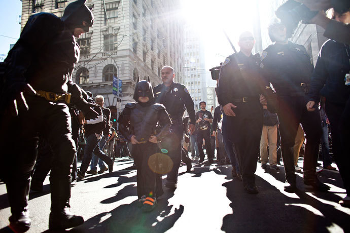 Police escorts leukemia survivor Miles, 5, dressed as BatKid, and Batman after they arrest the Riddler as part of a Make-A-Wish foundation fulfillment November 15, 2013 in San Francisco.(AFP Photo / Ramin Talaie)
