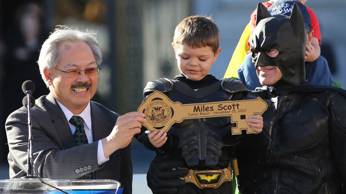 "Five-year-old leukemia survivor Miles Scott, dressed as ""Batkid"" receive a key to the city declaring him ""Junior Mayor"" from San Francisco Mayor Ed Lee (L) during a ceremony as part of a day arranged by the Make- A - Wish Foundation in San Francisco, California November 15, 2013.(Reuters / Robert Galbraith)"