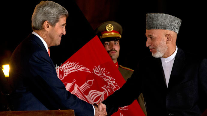 Afghanistan's President Hamid Karzai (R) shakes hands with US Secretary of State John Kerry after a news conference at the Presidential Palace in Kabul October 12, 2013.(Reuters / Jacquelyn Martin)