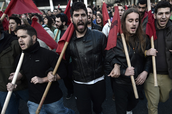 Protesters shout slogans on November 17, 2013 in the center of Athens during a march commemorating the 1973 students uprising against the military junta. Tens of thousands marched in Greece on November 17 (AFP Photo / Aris Messinis)