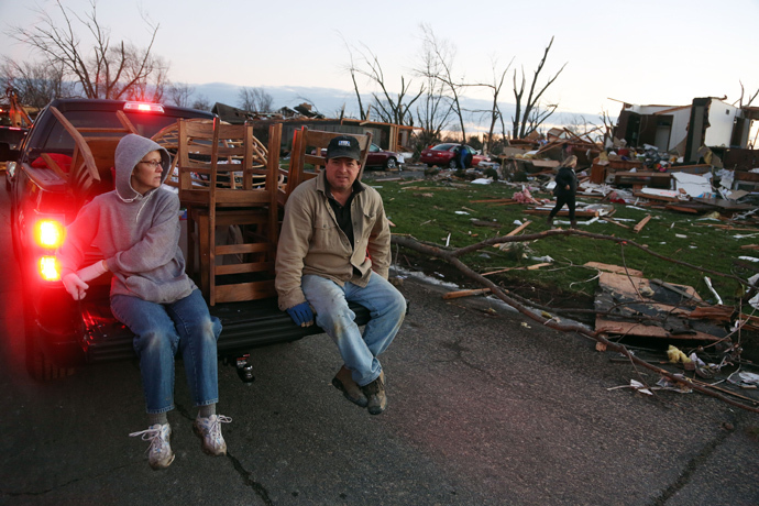 (L - R) Tina Junk and Gary Junk, residents of Elgin Avenue, salvage what remains after a tornado struck on November 17, 2013 in Washington, Illinois. (Tasos Katopodis / Getty Images / AFP)