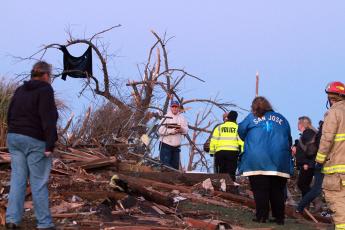 Residents of Elgin Avenue sort through debris after a tornado struck on November 17, 2013 in Washington, Illinois. (Tasos Katopodis / Getty Images / AFP)
