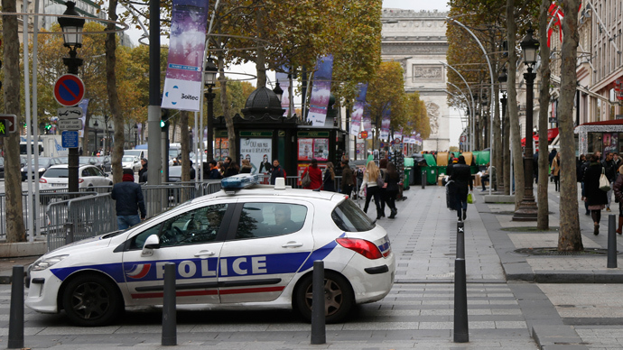 Gunman 'on the run and represents a real danger' in Paris after newspaper, bank shootings
