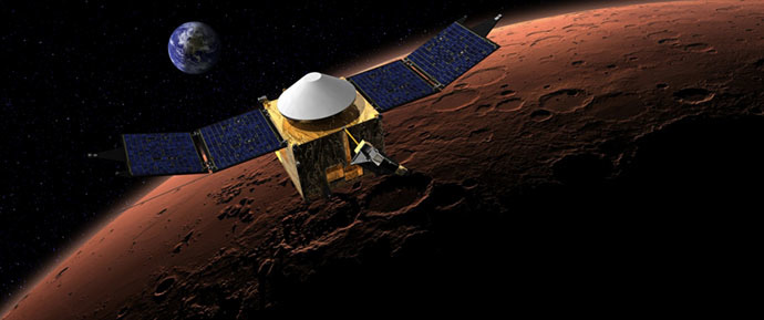This artist's concept shows the MAVEN spacecraft in orbit around the Red Planet, with a fanciful image of her home planet in the background. (Credit: NASA/Goddard)