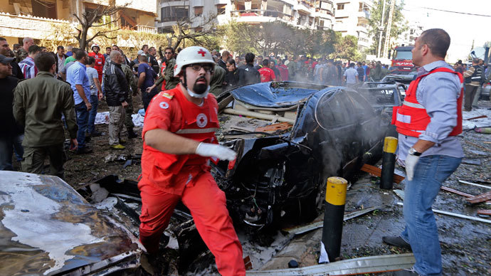 Soldiers, policemen and medical personnel gather at the site of explosions near the Iranian embassy in Beirut November 19, 2013.(Reuters / Hasan Shaaban)