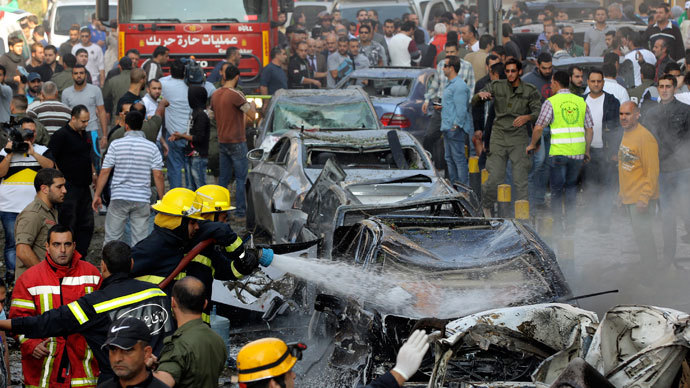 Civil Defence personnel extinguish a fire on cars at the site of explosions near the Iranian embassy in Beirut November 19, 2013.(Reuters / Mahmoud Kheir)
