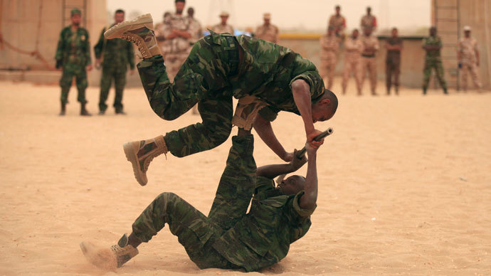 "Soldiers demonstrate unarmed combat techniques during a military graduation parade for trainees from the Libyan Army ""Thunderbolt"" Special Forces unit, in Benghazi May 16, 2013.(Reuters / Esam Al-Fetori)"