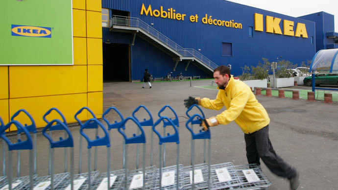 An employee of Swedish retailer IKEA works during a demonstration by employees to demand for salary increases, outside a store in Bordeaux, southwestern France, February 13, 2010.(Reuters / Olivier Pon)