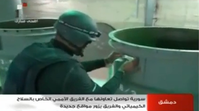 An image grab taken from Syrian television on October 19, 2013 shows an inspectors from the Organisation for the Prohibition of Chemical Weapons (OPCW) at work at an undisclosed location in Syria. (AFP Photo)
