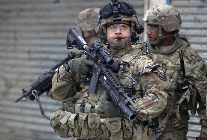 U.S. troops with the International Security Assistance Force (ISAF) keep watch at the site of a suicide attack in Kabul, February 27, 2013. (Reuters/Omar Sobhani)