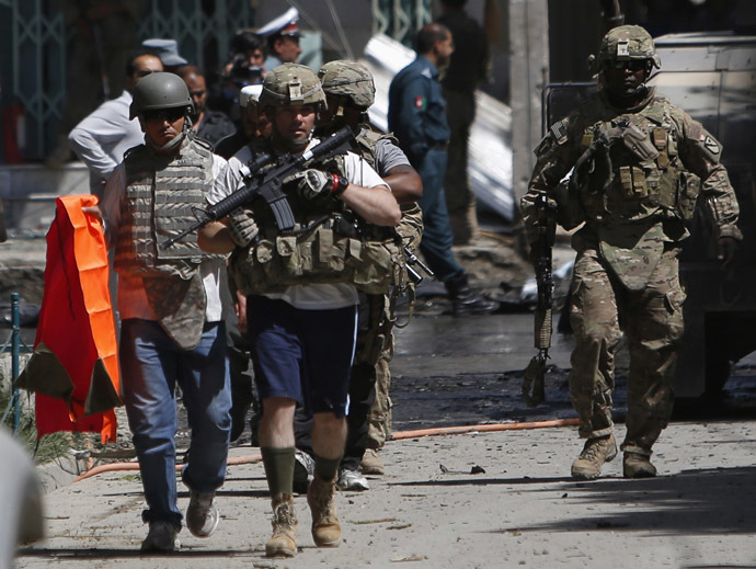 NATO soldiers with the International Security Assistance Force (ISAF) arrive at the site of a suicide attack in Kabul May 16, 2013. (Reuters/Mohammad Ismail)