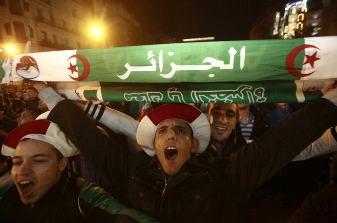 Fans of Algeria's soccer team celebrate in downtown Algiers after their team defeated Burkina Faso in their 2014 World Cup qualifying second leg playoff soccer match, November 19, 2013. (Reuters/Ramzi Boudina)