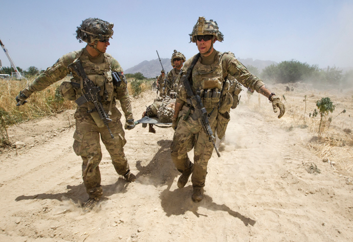 U.S. Army soldiers carry Sgt. Matt Krumwiede, who was wounded by an improvised explosive device (IED), towards a Blackhawk Medevac helicopter in southern Afghanistan (Reuters / Shamil Zhumatov)