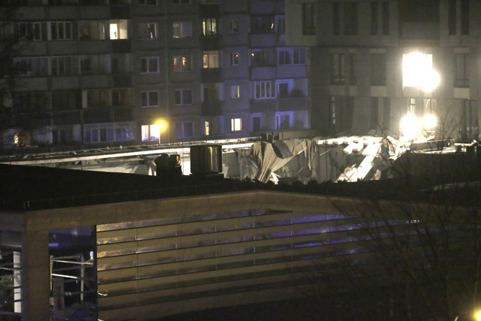 The collapsed roof of a store is pictured in Riga November 21, 2013. (Reuters/Ints Kalnins)