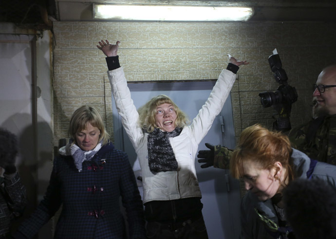 Sini Saarela of Finland (C) reacts after she was released from prison in St. Petersburg November 21, 2013. (Reuters/Alexander Demianchuk)