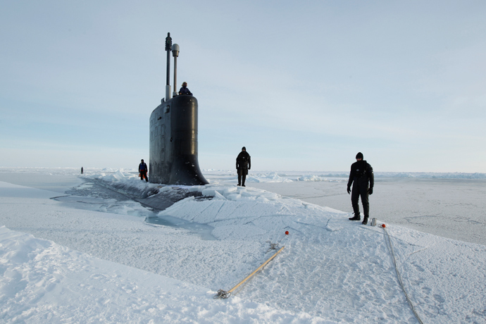 U.S. Navy safety swimmers stand on the deck of the Virginia class submarine USS New Hampshire after it surfaced through thin ice during exercises underneath ice in the Arctic Ocean north of Prudhoe Bay, Alaska (Reuters / Lucas Jackson)