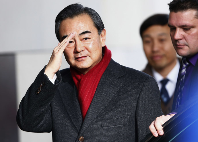 Chinese Minister of Foreign Affairs Wang Yi waves on his arrival at the Intercontinental hotel where talks are being held in Geneva November 23, 2013. (Reuters/Denis Balibouse)
