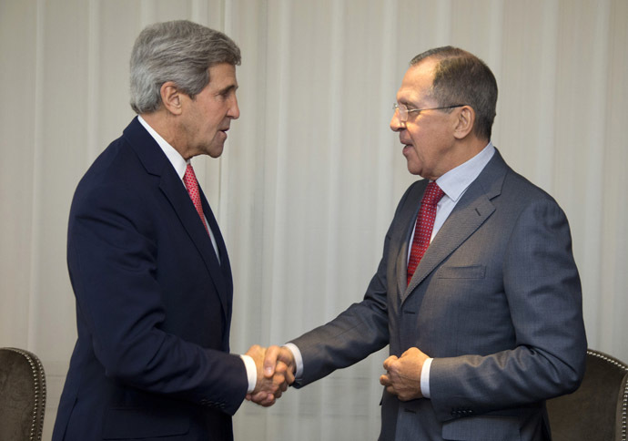 U.S. Secretary of State John Kerry (L) and Russia's Foreign Minister Sergei Lavrov shake hands during a photo opportunity prior to their meeting, in Geneva November 23, 2013. (Reuters/Carolyn Kaster)