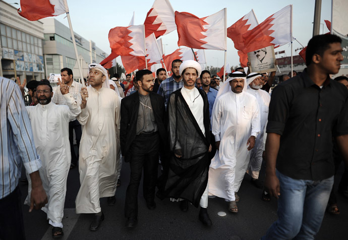 Bahrain's Al-Wefaq opposition group leader Sheikh Ali Salman (C) takes part in an anti-government protest in the village of Bilad al-Qadeem, in a suburb of the capital Manama, on November 22, 2013. (AFP Photo/Mohammed Al-Shaikh)