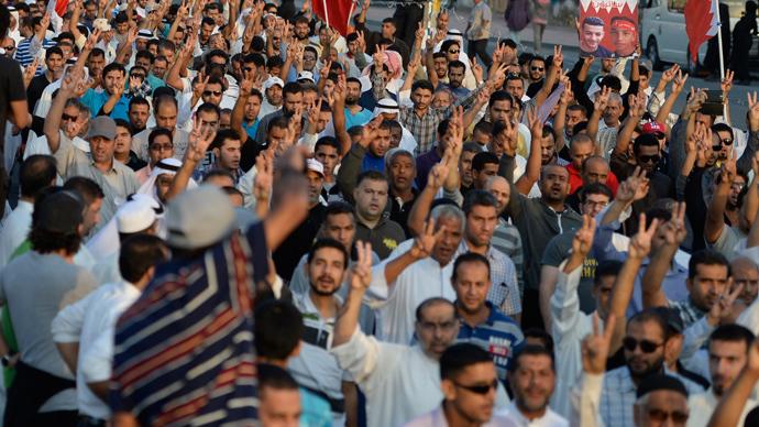 Bahrain court jails 12 protesters, acquits policeman