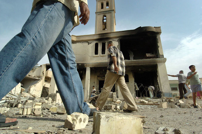 Iraqi people gather outside of a destroyed church following an explosion in Baghdad.(AFP Photo / Jewel Samad)