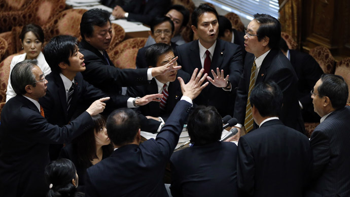 Japan's ruling coalition pushes heavy-handed state secrets bill through lower house