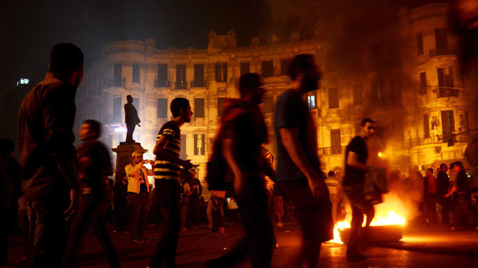 Egyptian protesters set fire to wood at Talaat Harb Square in downtown Cairo on November 26, 2013.(AFP Photo / Mohamed Abdelwahab)