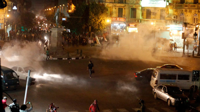 Tear gas fired by riot police at protesters fill the air during clashes at Talaat Harab square in downtown Cairo November 26, 2013.(Reuters / Mohamed Abd El Ghany)