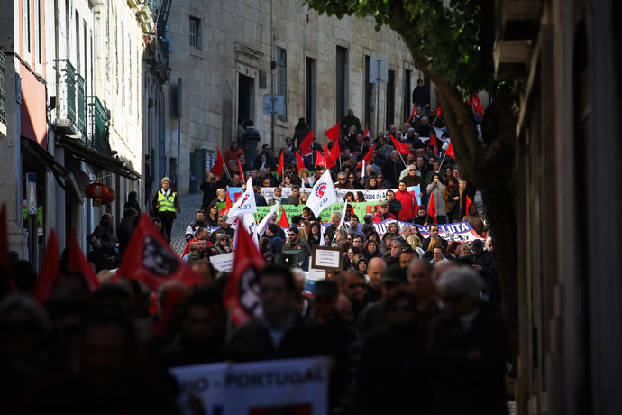 Protestors march as they protest during the vote of the 2014 State Budget in downtown Lisbon on November 26, 2013.(AFP Photo / Pedro Nunes)