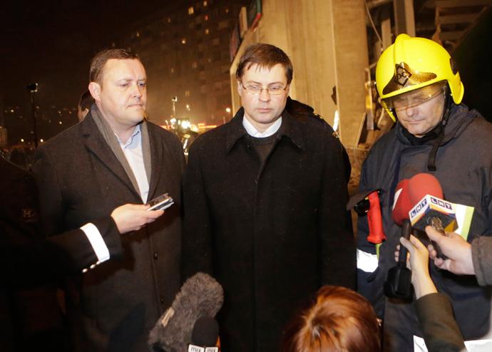Latvia's Prime Minister Valdis Dombrovskis (C) (Reuters)