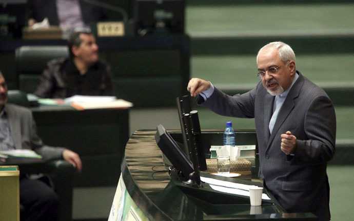 Iranian Foreign Minister Mohammad Javad Zarif addresses the parliament in Tehran on November 27, 2013, as MPs were reviewing the accord struck with world powers on the weekend over Iran's controversial nuclear programme. (AFP Photo / Atta Kenare)