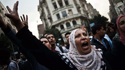 Tear gas, stones, clashes in Cairo amid new anti-protest law