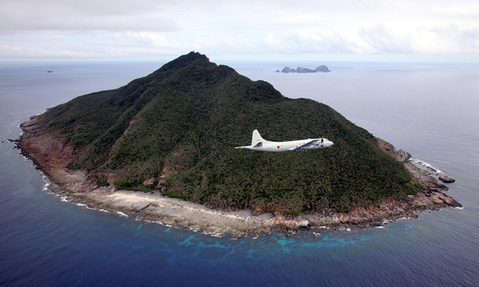 P-3C patrol plane of Japanese Maritime Self-Defense Force flying over the disputed islets known as the Senkaku islands in Japan and Diaoyu islands in China, in the East China Sea. (AFP Photo / Japan Pool via JIJI Press Japan out)