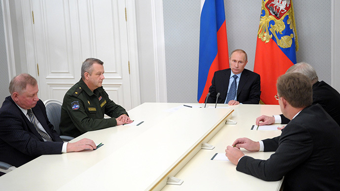 Russian President Vladimir Putin, center, chairs a meeting in Bocharov Ruchey residence on aerospace defense issues on 28 November 2013. (RIA Novosti / Aleksey Nikolskyi)
