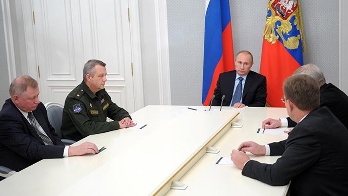 Russian President Vladimir Putin, center, chairs a meeting in Bocharov Ruchey residence on aerospace defense issues on 28 November 2013. (RIA Novosti / Aleksey Nikolskyi)