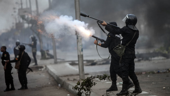 Egyptian Riot policemen fire tear gas towards protesters during a demonstration of Muslim Brotherhood and ousted President Mohamed Morsi on November 29, 2013 in Cairo, Egypt. (AFP Photo / Mahmoud Khaled)