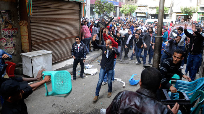 Activists and supporters of Ahmed Maher, founder of the April 6 movement, clash with security forces outside Abdeen court in Cairo November 30, 2013.(Reuters / Stringer)