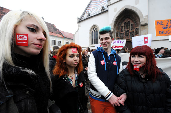 "Croatian gay rights supporters sporting stickers reading ""Vote against"" take part in a protest outside the parliament building in Saint Marko Square in Zagreb on November 30, 2013 .(AFP Photo / STR)"
