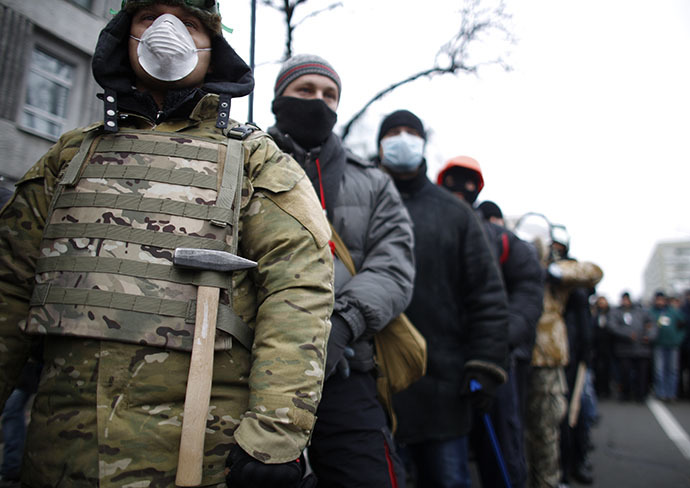 People wear masks as they attend a rally held by supporters of EU integration in Kiev, December 1, 2013. (Reuters / Stoyan Nenov)